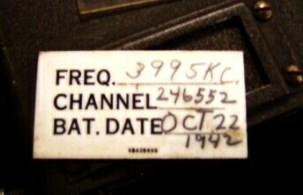 Closeup photo of Frequency, Channel, Battery Date card for BC-721 A radio