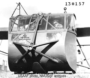 USAAF Wright Field photo #130157 at CCAAF, new Bolt-on Griswold nose protection device showing receptacle for wire-on-tow-line interphone wire connection.