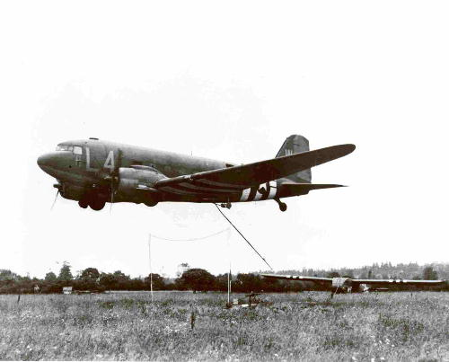 Glider at rest is being snatched airborne by C-47
