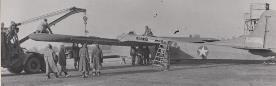 Service Command mechanics attach a wing to one of the