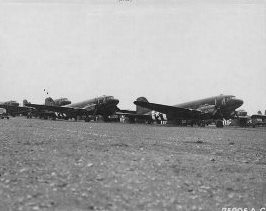 Tow planes and gliders of the 439th Troop Carrier Group are lines up on the