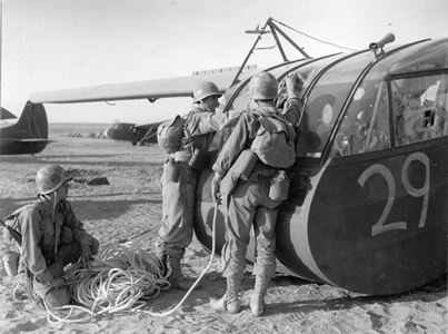 Artillermen hooking up tow rope to CG–4A glider.  African Air Force